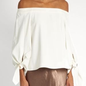 tibi off shoulder buckle couture top